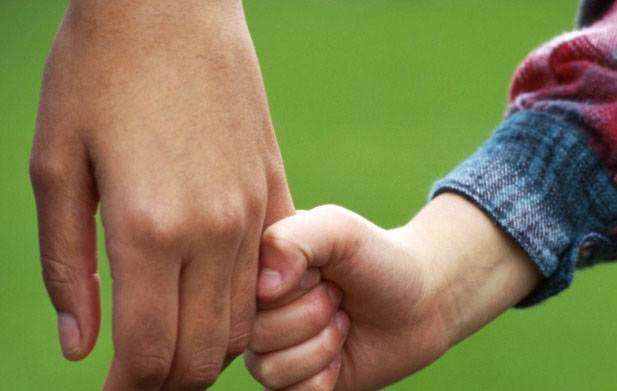 SVP-child-holding-parents-hand